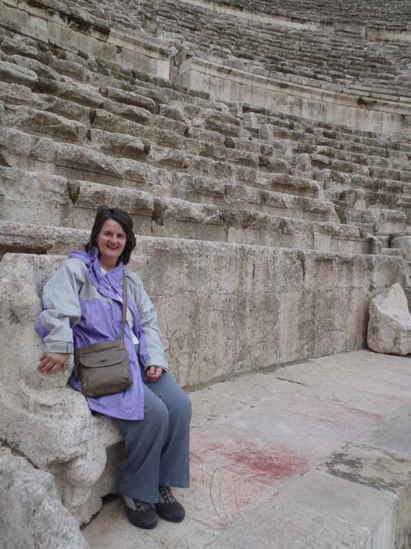 Mum sitting in a Roman colloseum